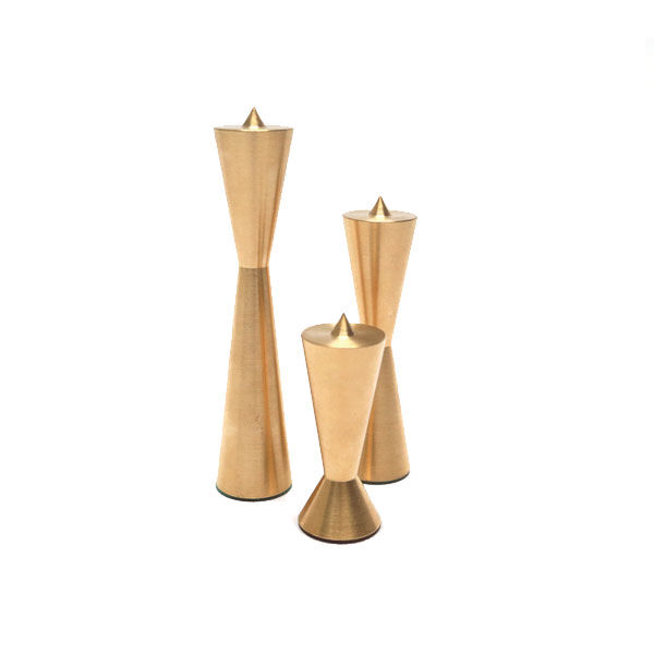 Machined brass candle holders that are stackable and feature a leather bottom
