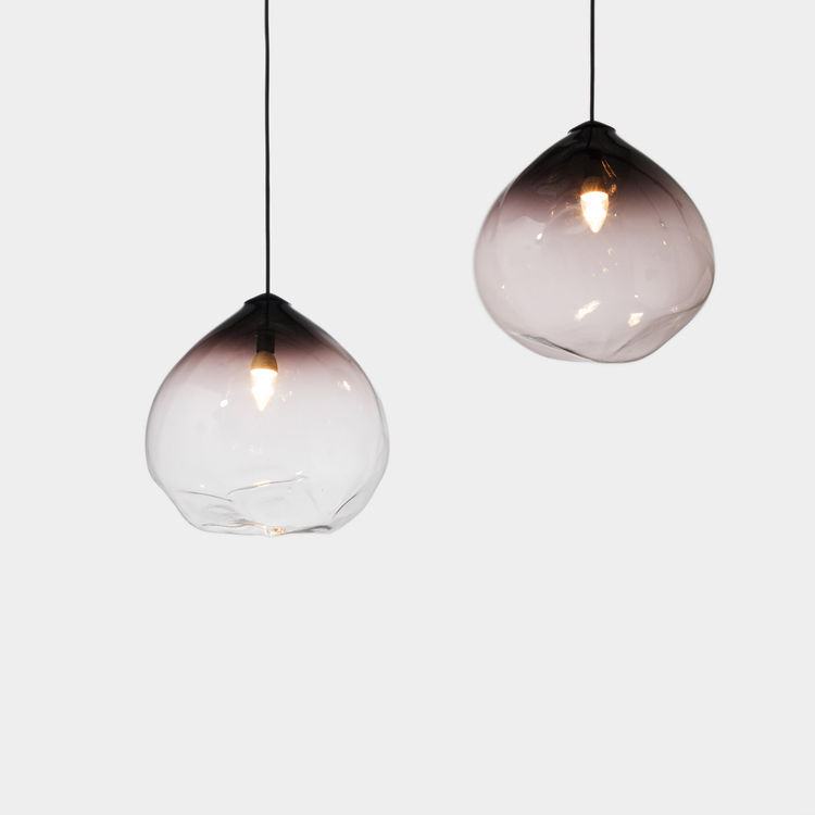 Sculptural mouth blown glass pendant light with black and clear glass and LED lamp