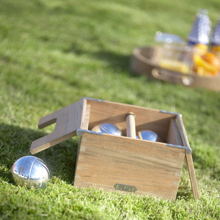 Teak and chrome petanque bocce set for outdoor play