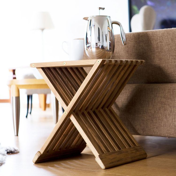 Teak folding stool that can be used as side table or seat inside and outdoors