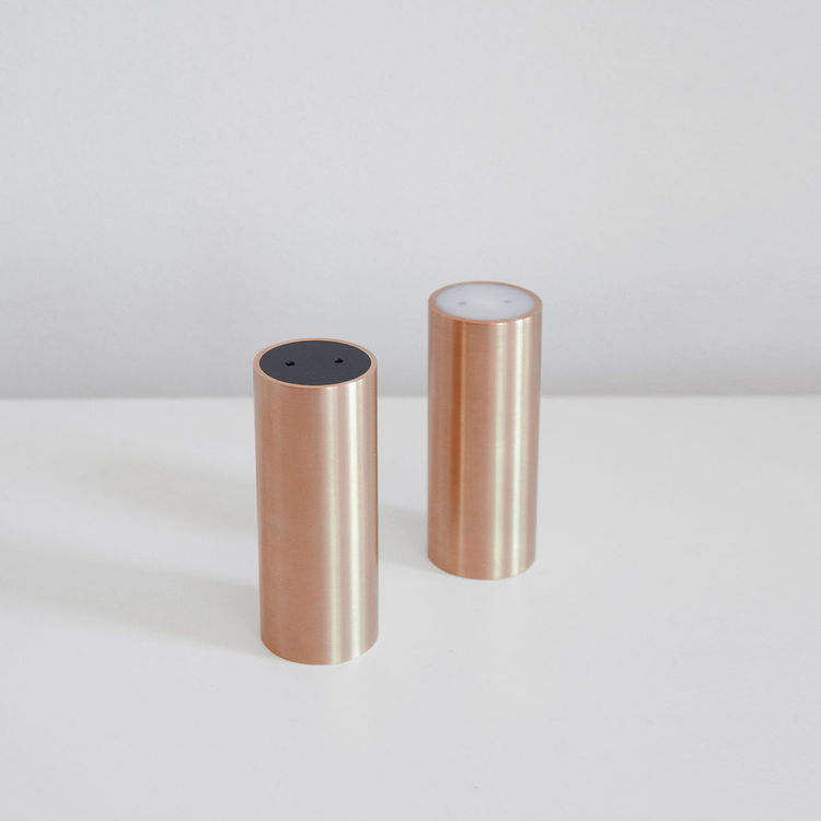 Salt and pepper shakers crafted from copper or brass