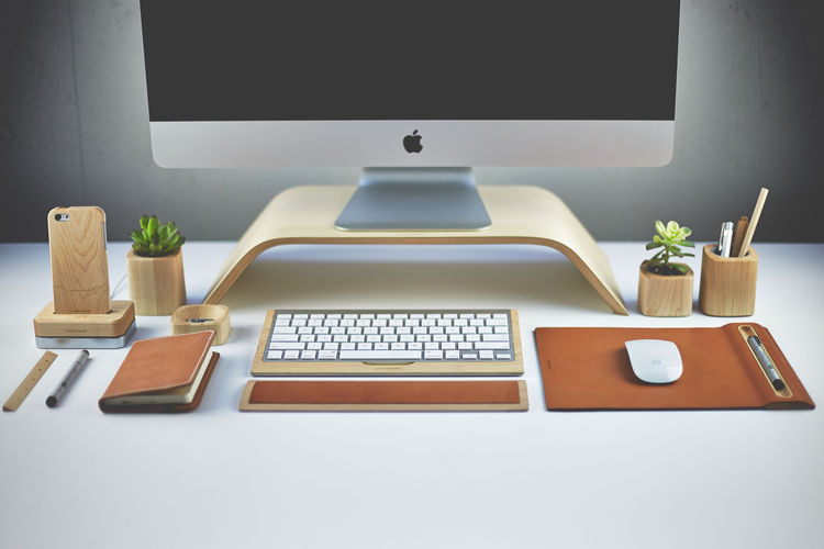 Desk with modern wood accessories in maple