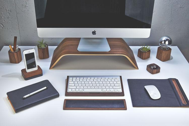 Desk with modern wood accessories in walnut