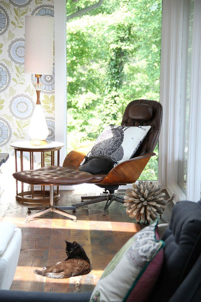 Vintage Plycraft chair paired with floral blue wallpaper in the Ohio home of designer Amy Butler.