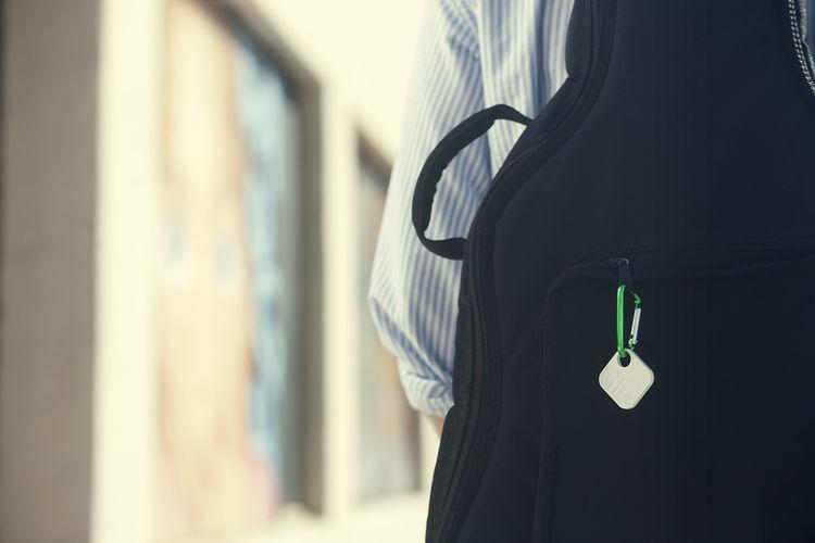 Tile transponder on keychain on backpack