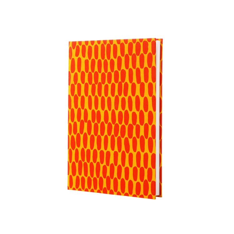 Bright cotton-covered notebook with blank pages