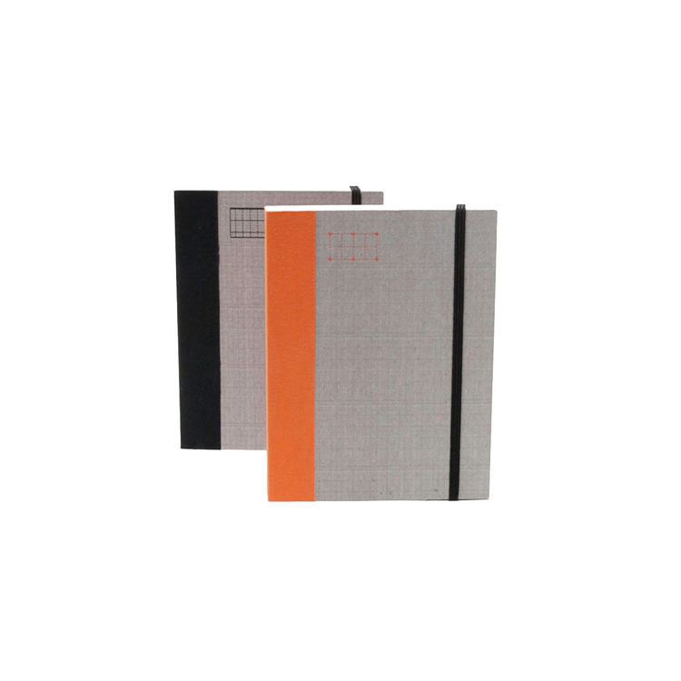 Fabric-covered notebook and planner with small silhouette
