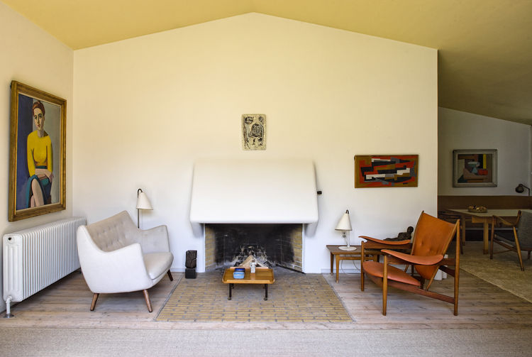 Finn Juhl's modernist living room with a Poet sofa