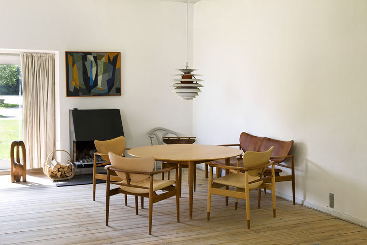 Finn Juhl's seating area with class midcentury furniture