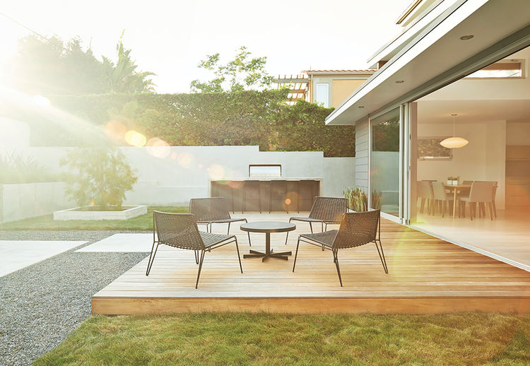 California backyard wooden deck with sun rays