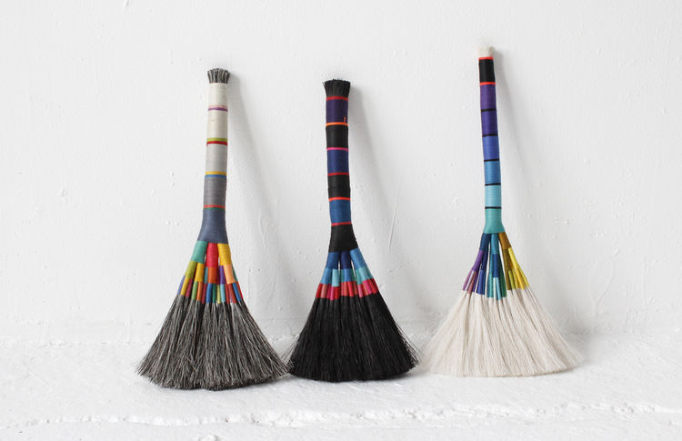 Colorful brooms made of horse hair