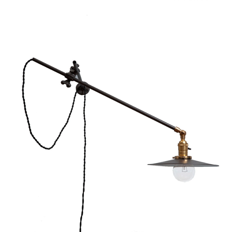 Industrial wall lamp with a hanging cord