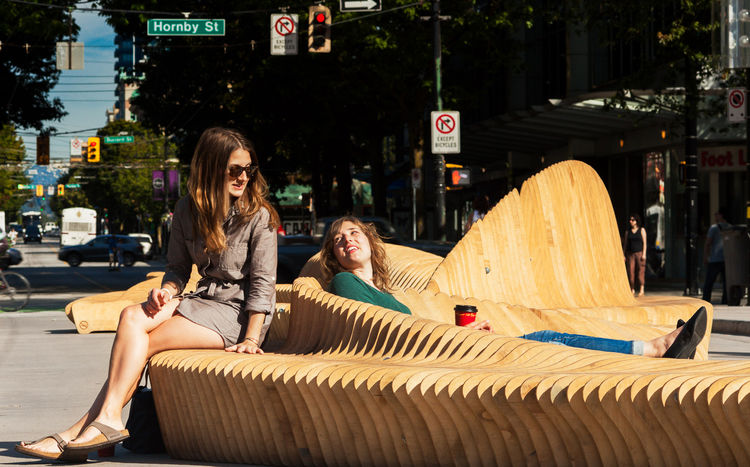 Curved wooden public bench in Vancouver