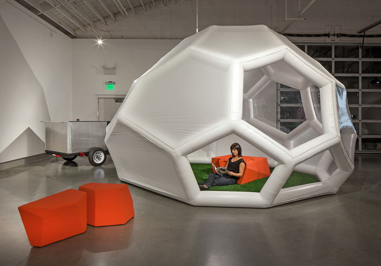 Geometric inflated dwelling with a trailer