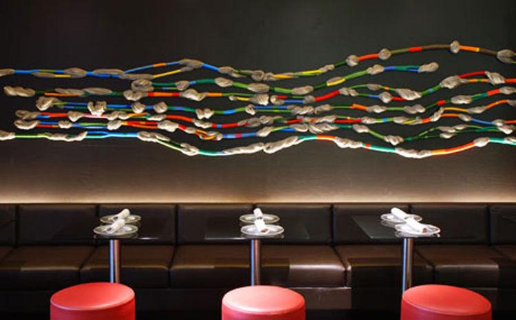 Massimo and Lella Vignelli's interior design for SD26 restaurant in New York City includes fiber art by Sheila Hicks.