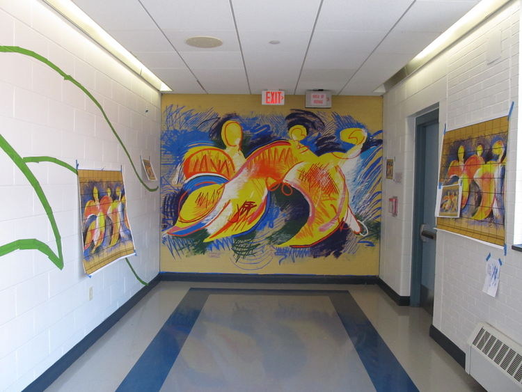 Finished mural at the end of a high school hallway