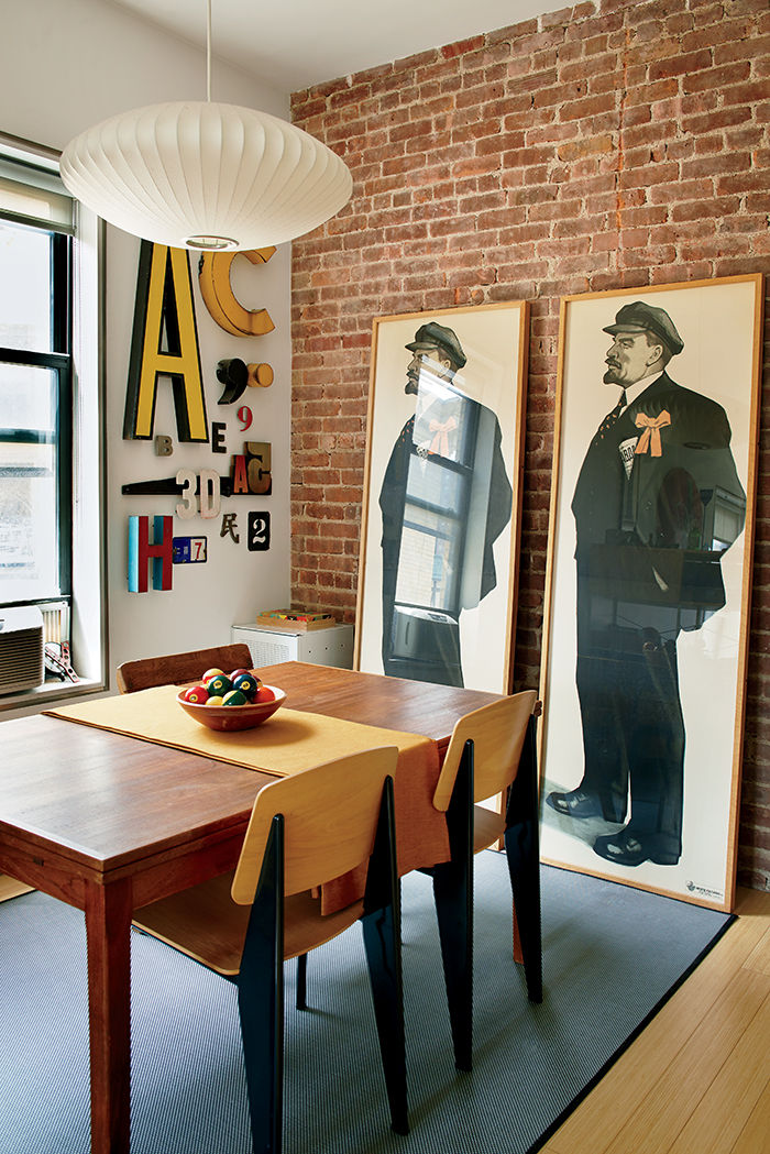 Dining room with Jean Prouvé chairs and Lenin prints