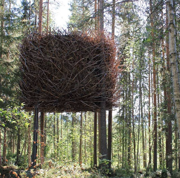 Bird's nest suspended treehouse with branches on the outside