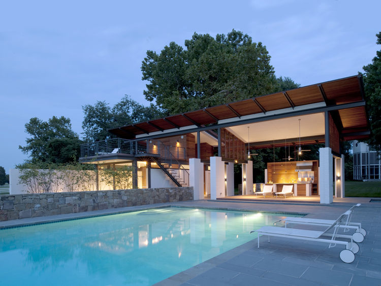 Poolside shading structure with kitchen area
