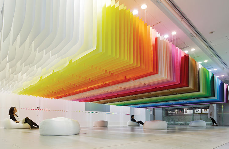 Suspended sheets of paper in a rainbow of colors