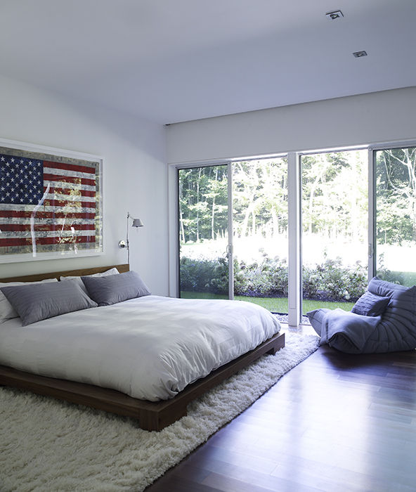Hamptons bedroom with glass walls and American flag print
