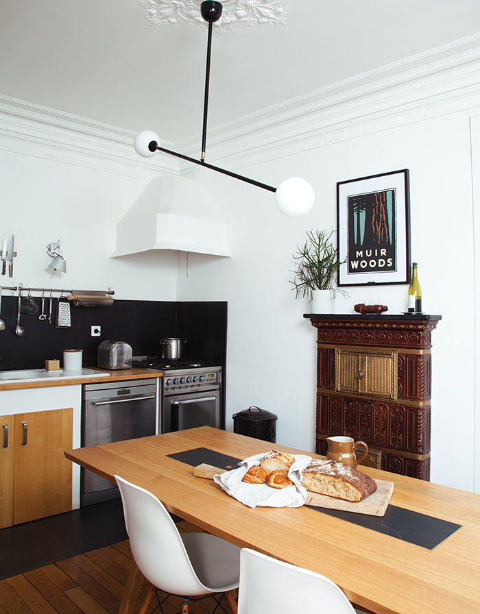 Kitchen with wood and stone dining table and ceiling lamp
