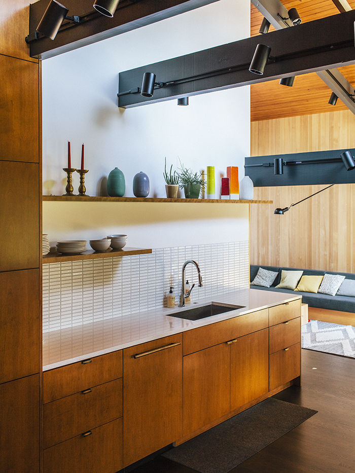 White Ann Sacks tile in midcentury Portland kitchen with wood cabinets