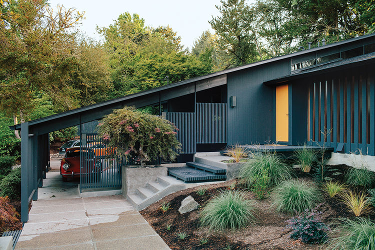 Midcentury house in Portland with iron colored facade and gold front door  The Best Midcentury Modern Homes Across America midcentury renewal portland black exterior gold front door