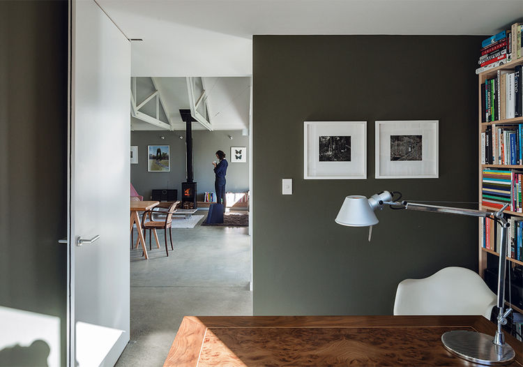 New Zealand office with gray walls and Tolomeo desk lamp from Artemide