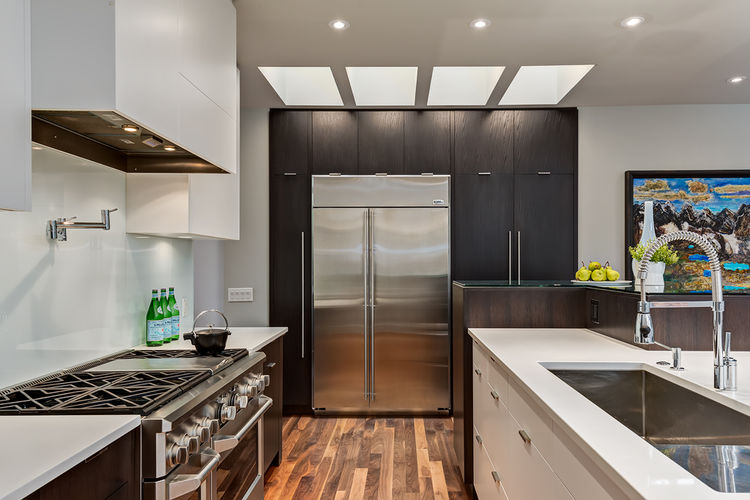 Kitchen with custom oak cabinetry in Calgary residence designed by DOODL.
