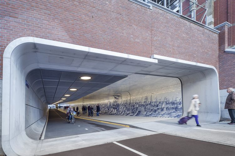 Dutch tunnel for cyclists and pedestrians adorned with Delft blue tiles.
