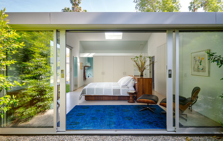 Floor to ceiling sliding glass doors in the master bedroom of a Bel Air ranch-style home  The Best Midcentury Modern Homes Across America bel air house master bedroom