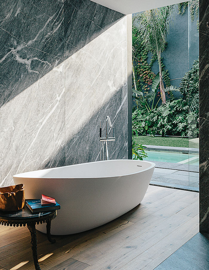 Bathroom tub overlooking a courtyard in a Mexico City home