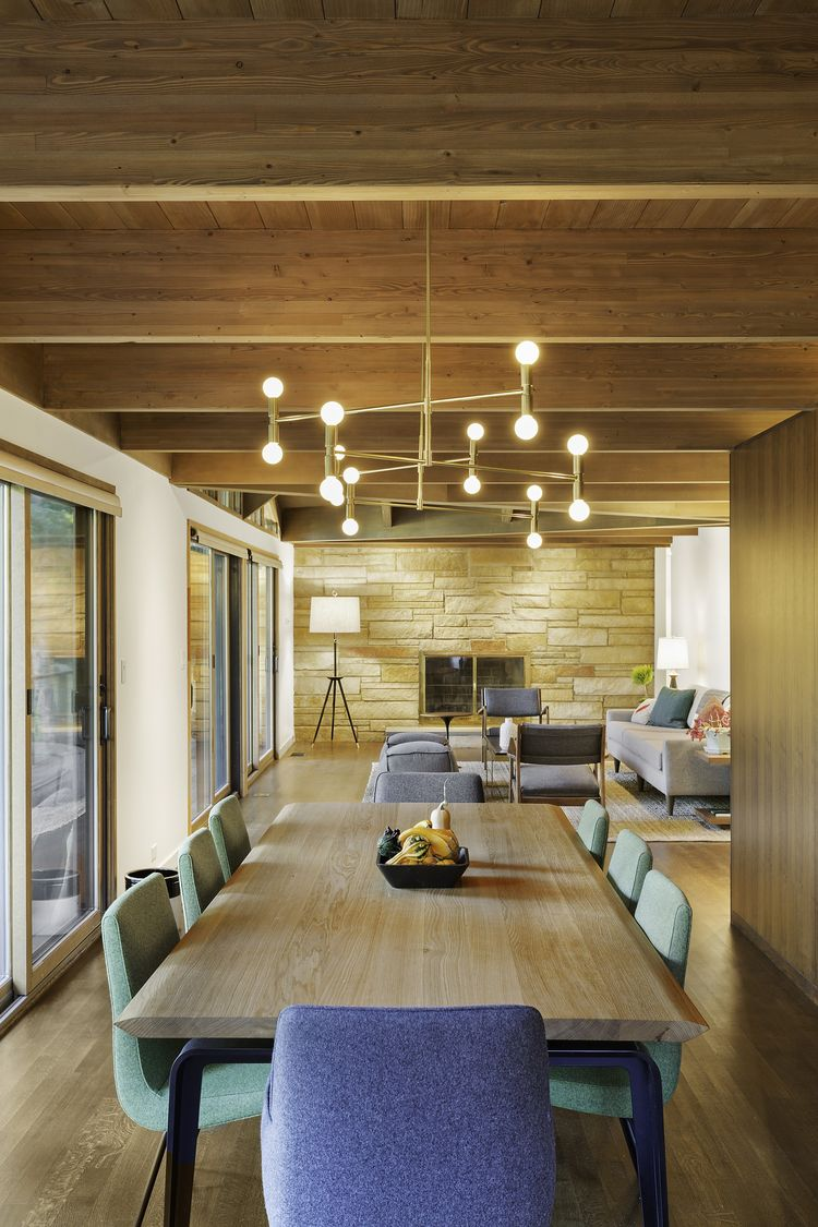 Lambert & Fils light fixture and Ligne Roset dining set in Westchester renovation by Khanna Shultz.