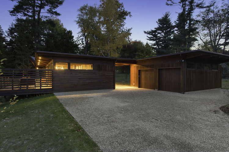 Stained western red cedar facade of Westchester renovation by Khanna Shultz.