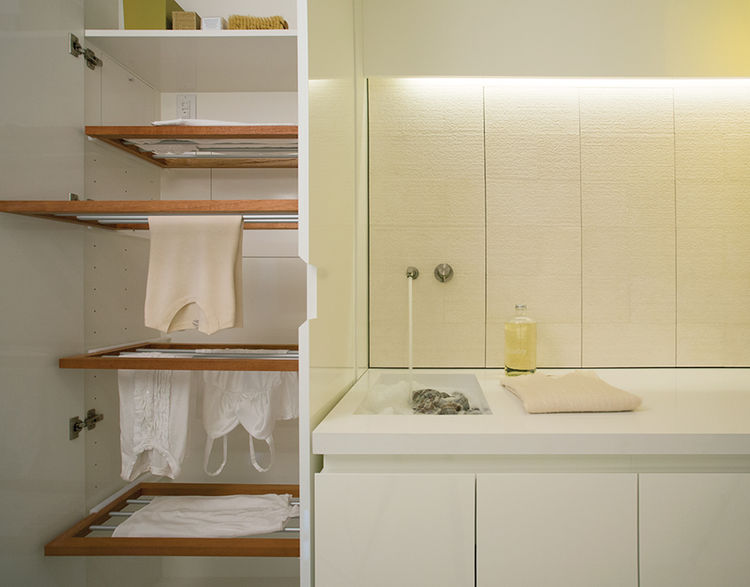 Modern laundry room with hidden custom drying rack
