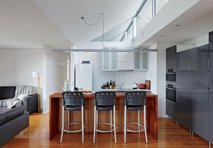 Kitchen with Miele appliances and IKEA cabinets in Tasmanian prefab by Misho+Associates.