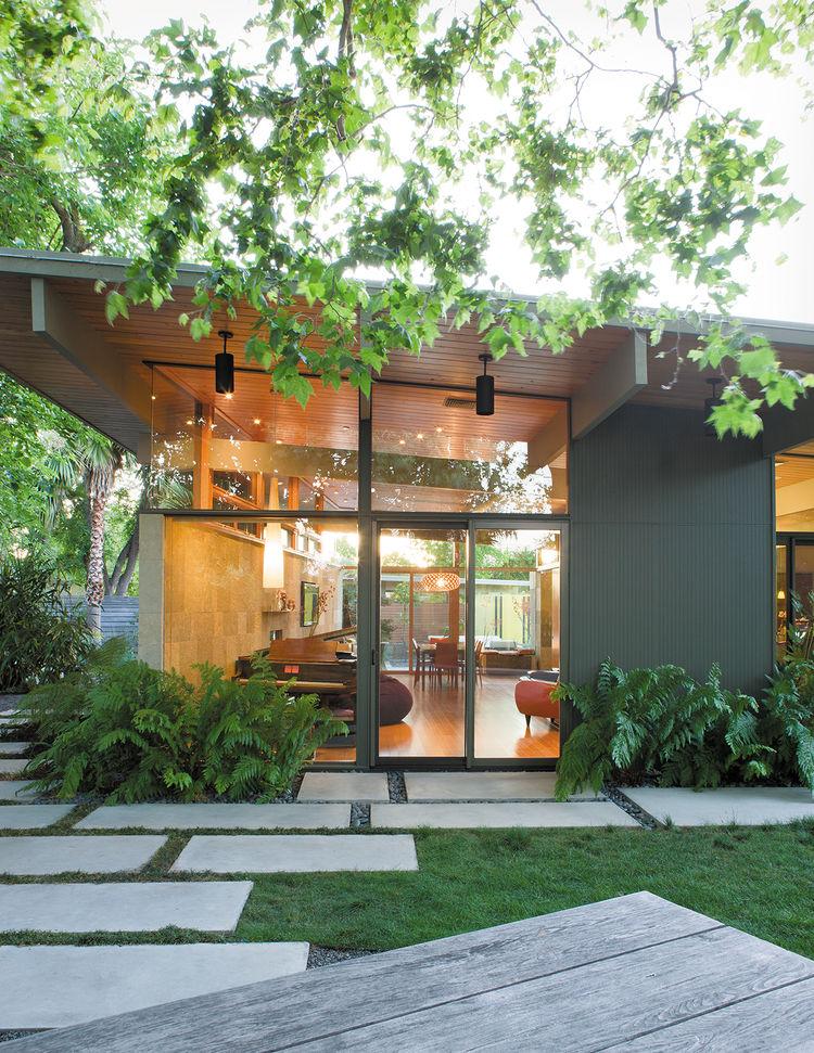 modern backyard garden overhang plants concrete pavers