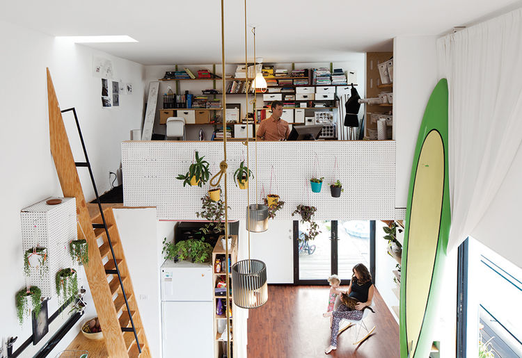 Modern micro-living, live-work unit with pegboard mezzanine