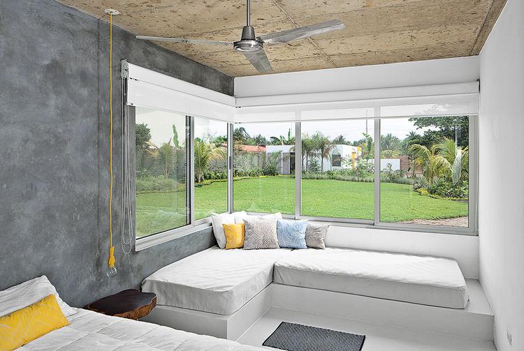 modern beach house master bedroom concrete walls