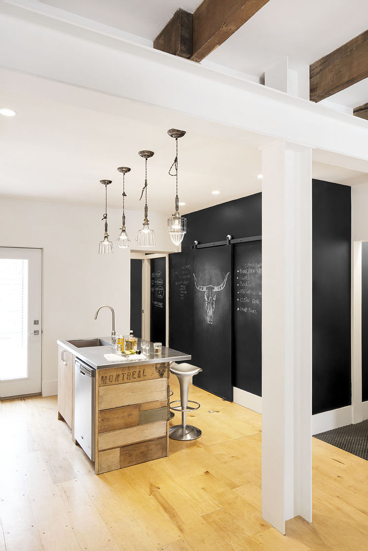 Montreal renovated row house kitchen with a chalkboard wall