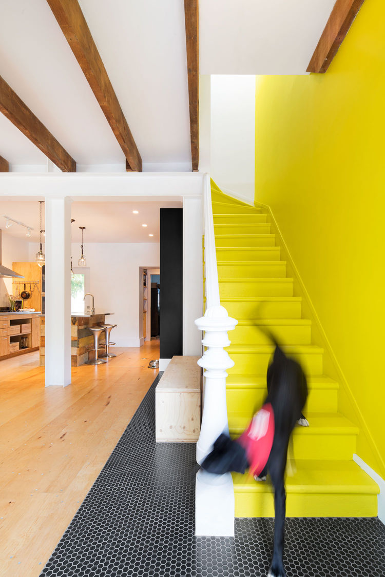 Montreal renovated row house with  yellow stairs