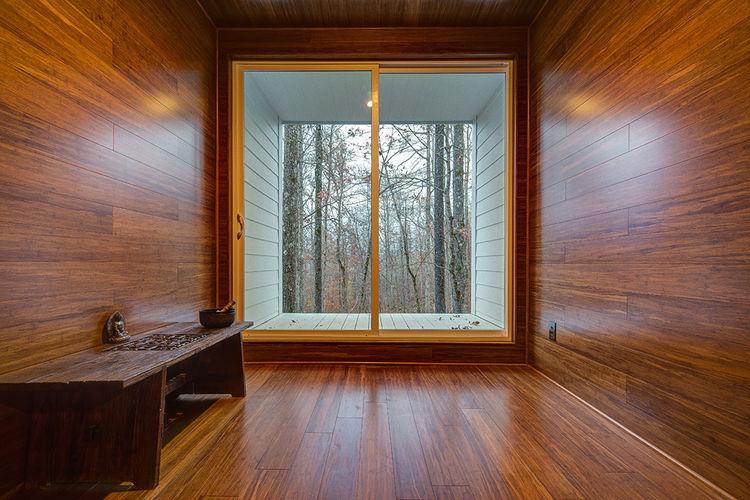 modern green arkansas cabin bamboo wood buddhist