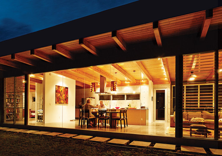 Modern concrete house in Hawaii with dining room and bamboo table