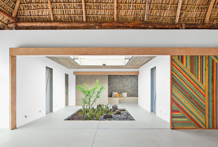 modern beach house thatch roof secret garden indoor sliding walls