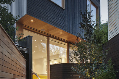 Black wood facade of Toronto renovation by Modern Nest Design + Construction.