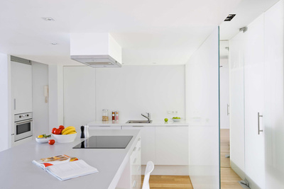 Modern kitchen design with white cabinets and countertops