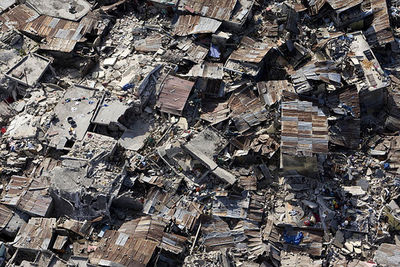 An aerial view of an impoverished neighbourhood in Port-au-Prince demonstrates the extent of damage inflicted by the powerful earthquake that rocked the Haitian capital on 12 January. 13/Jan/2010. Port-au-Prince, Haiti. UN Photo/Logan Abassi. www.un.org/a