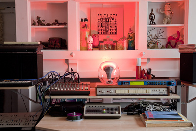 "Grawe, a musician, grouped a collection of artifacts from his travels around the world near his vintage keyboards and drum machines. The <a href=""http://www.coloryourworldsweeps.com"">LivingColors lamp</a> highlights the crannies of the room's built-in she"
