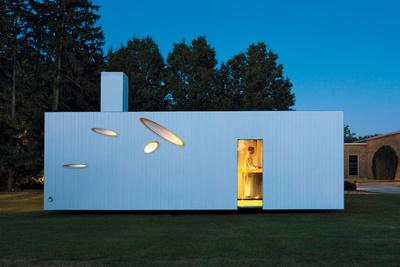 Washington prefab home with white facade and oval slat windows
